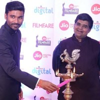 Actor Dhanush and Jitesh Pillai , Editor Filmfare at the press conference to announce 64th edition of JIO Filmfare Awards South 2017