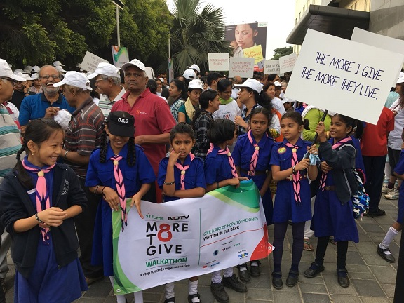 Students with #more to give slogans