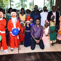 Actro Rishi and Dr IG Periaswamy, Chairman, Le Royal Meridien with children from Indian Youth villages fellowship children's Home