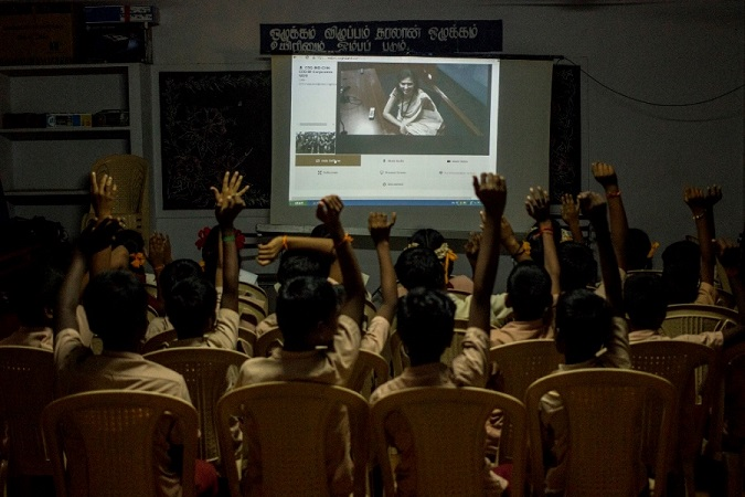 An Outreach volunteer interacting with students over videoconferencing (1)