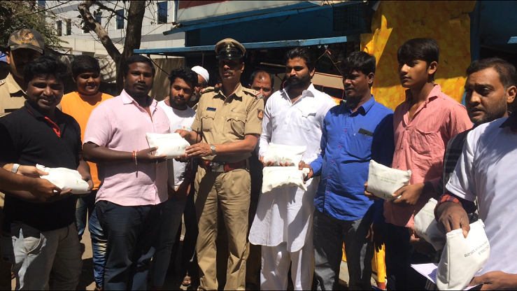 Bengaluru Police giving away the kit to the people during the Tobacco cessation drive