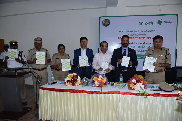 Dr Manish Mattoo, Dr Samir Parikh and Mr Raj Gore along with team of policemen during the book launch of tool kit for self care