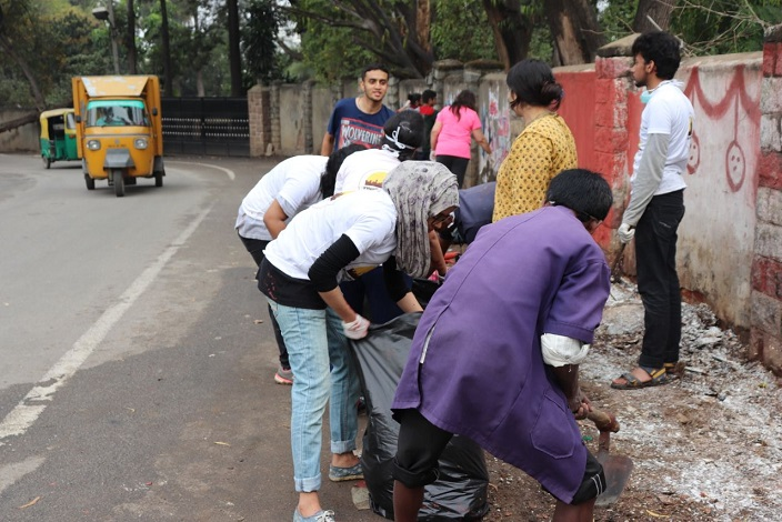 Students cleaning the lane during the cleanliness
