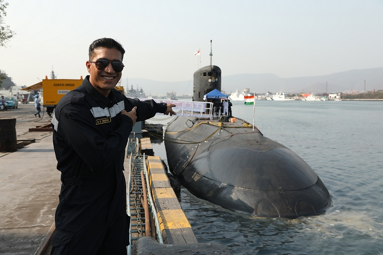 Harman Singha in front of INS Sindhukirti II.