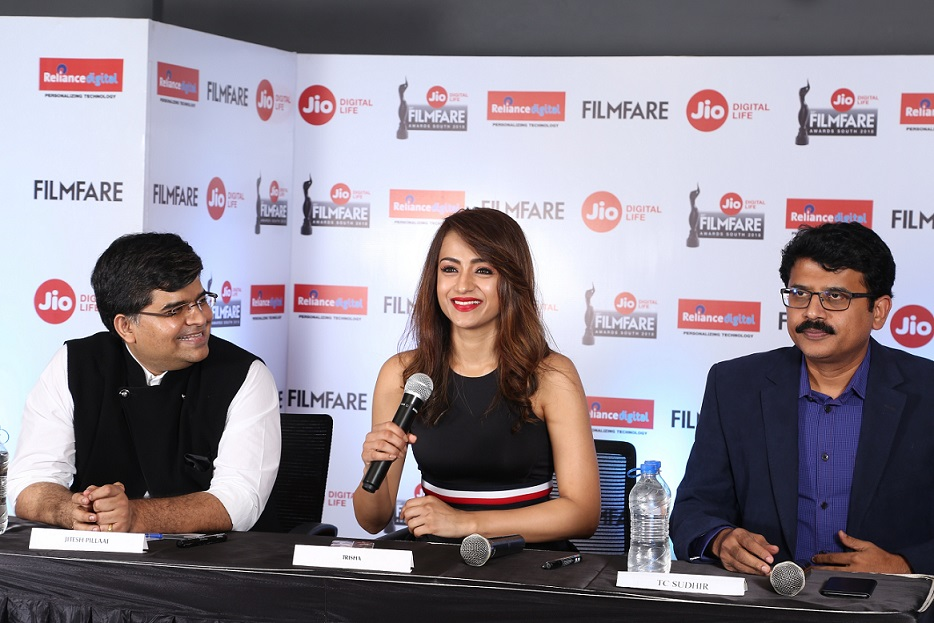 (L-R) Editor of Filmfare, Mr. Jitesh Pillai, Actress Trisha Krishnan, Sr. Vice President of Reliance Jio Infocomm Ltd- Sudhir TC at the 65th Jio Filmfare Awards South 2018