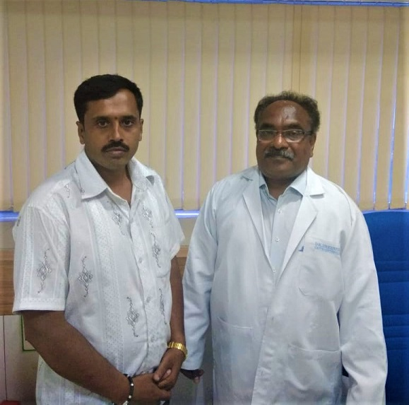 Dr Sreenivasa D along with Ambareesh