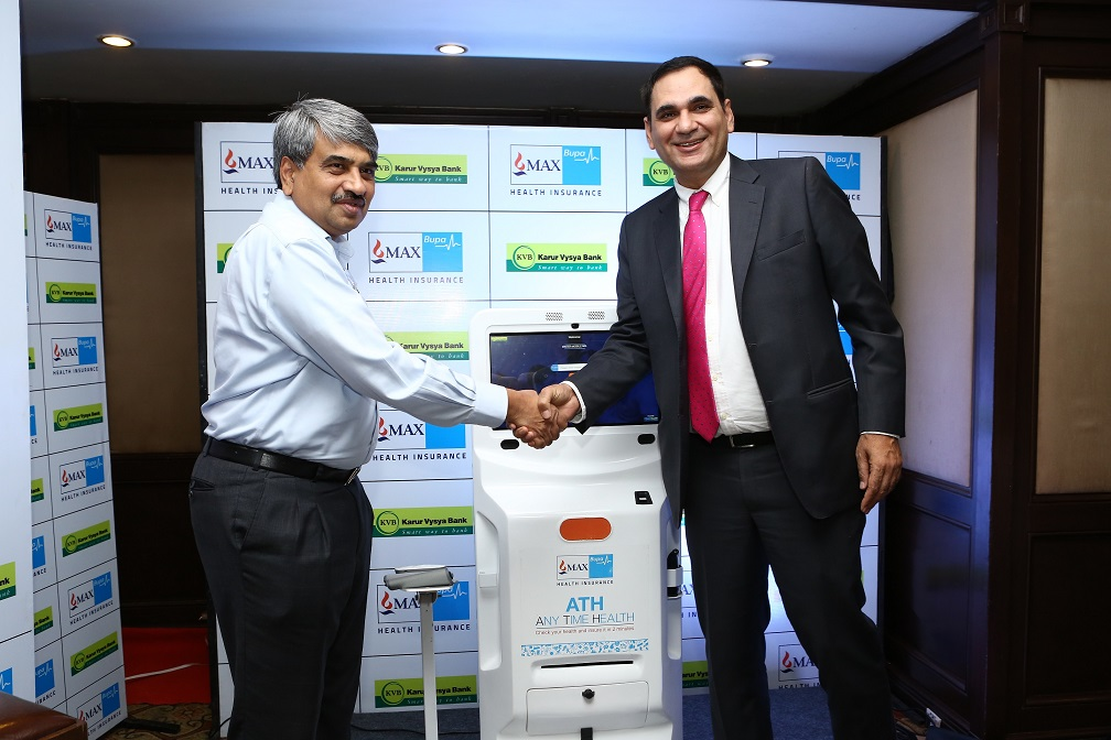 Mr.Ashish Mehrotra, MD & CEO, Max Bupa Health Insurance alongwith Mr.P R Seshadri, MD & CEO, Karur Vysya Bank with the Max Bupa AnyTimeHealth machine