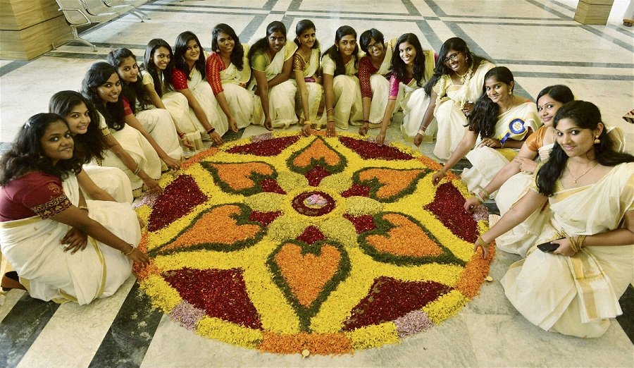 """Chennai: College students celebrate Onam festival by decorating """"Pookalam"""" at their College campus in Chennai on Wednesday. PTI Photo  (PTI8_26_2015_000112A)"""