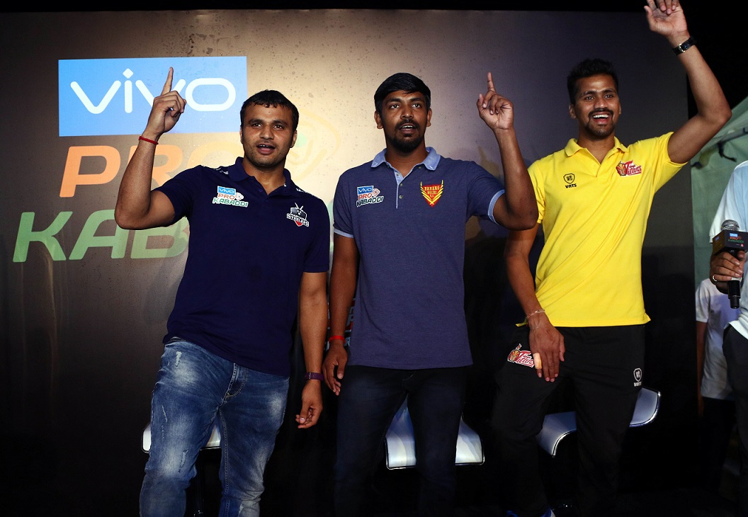 L-R Wazir Singh (Haryana Steelers), Chandran Ranjit (Dabang Delhi) and Nilesh Salunke (Telugu Titans) at Elliot's beach in Chennai for Kabaddi Beach Festival