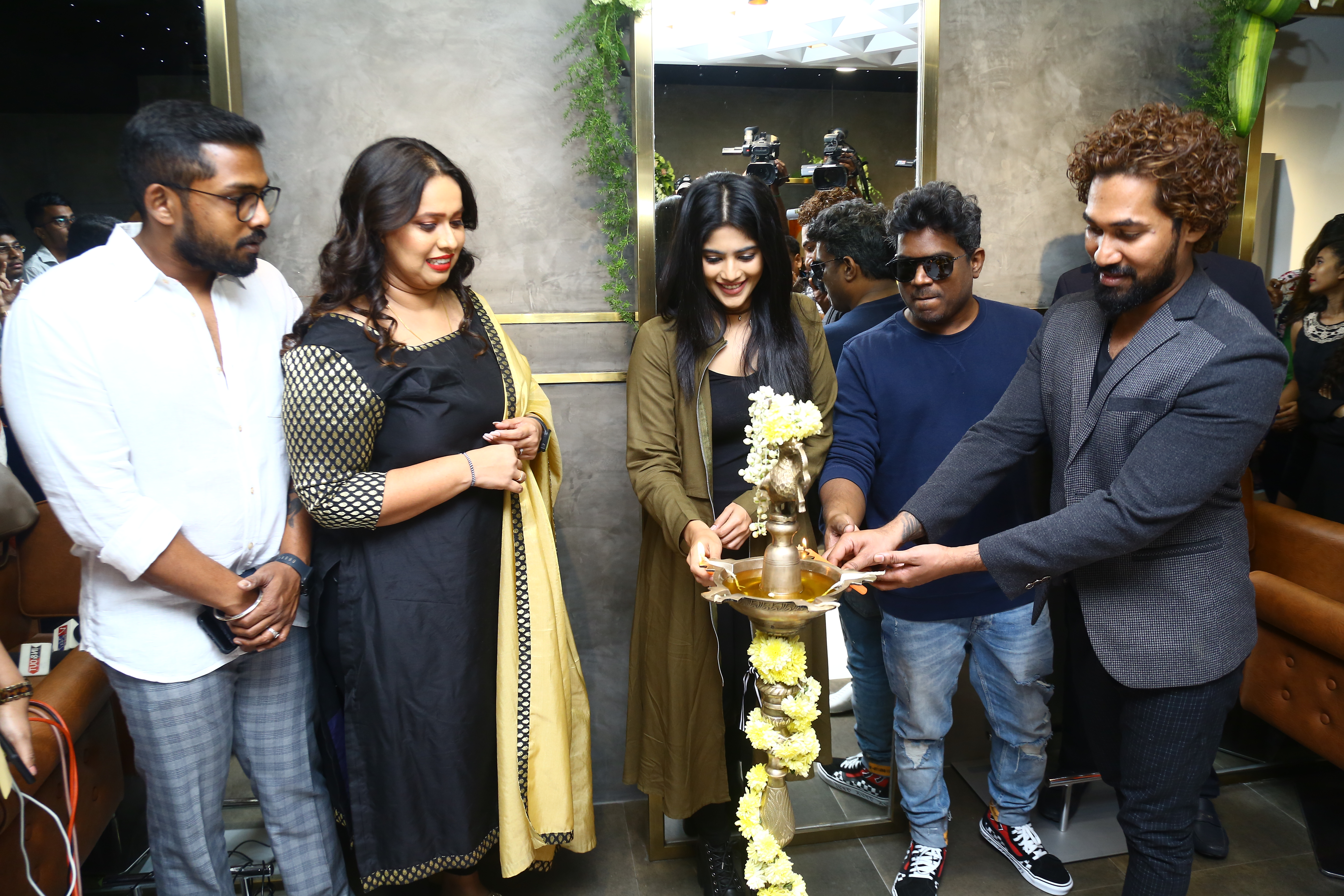 Megha Akash & Yuvan Shankar Raja lighting the lamp along with Owner Swetha Sada